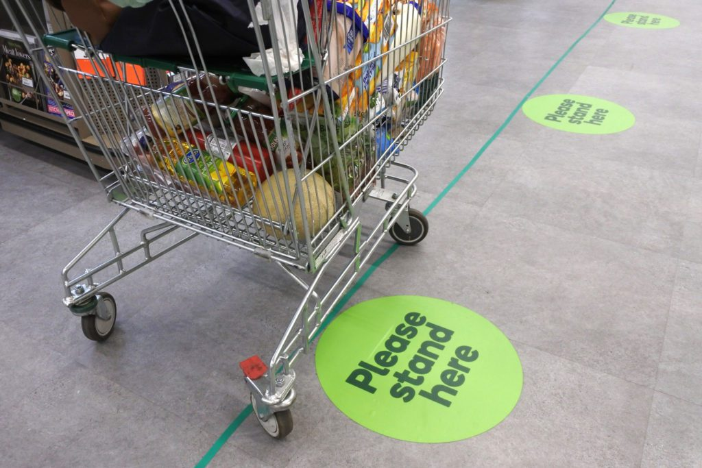 Social Distancing Marks On Supermarket Floor Intended To Stop Or Slow Down The Spread Of A Contagious Coronavirus (covid 19) Disease.